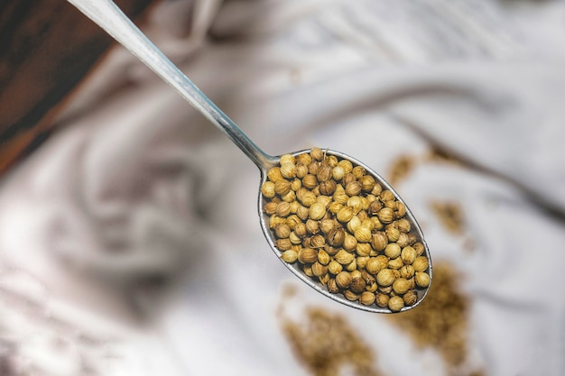 Coriander seeds in a spoon