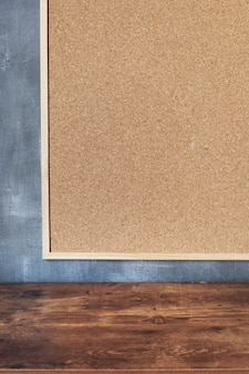 Cork board frame at concrete painted wall background texture surface