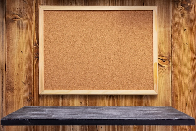 Cork board on wooden wall background texture