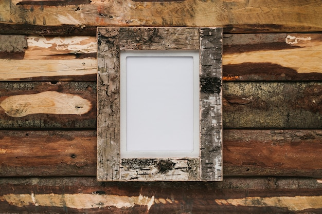 Cork frame on wooden background