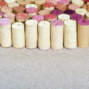 Cork from wine bottles standing in a row and free space