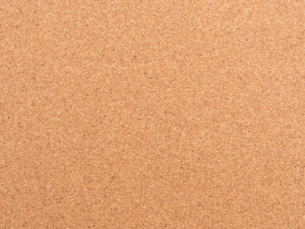 Corkboard background. brown paper texture. abstract pattern. wood backdrop. cardboard wall. plywood. cork texture