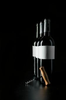 Corkscrew near wine bottles
