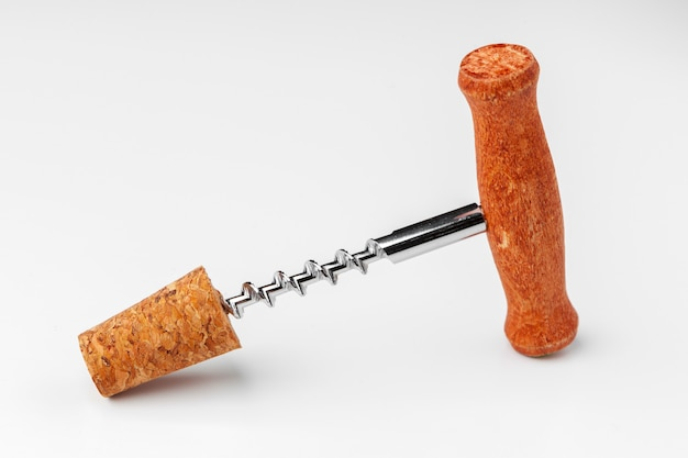 Corkscrew and wine cork isolated