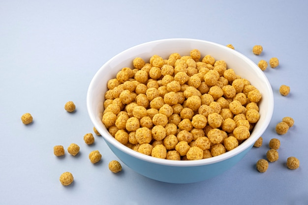 Corn balls in bowl on white background with copy space