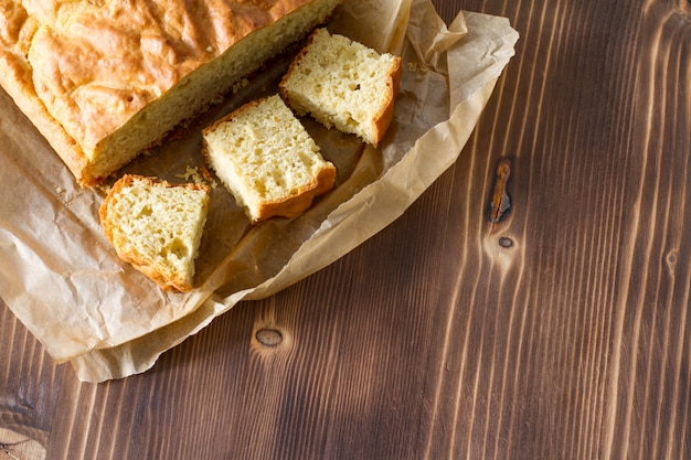 Corn bread cut in peaces on wood background