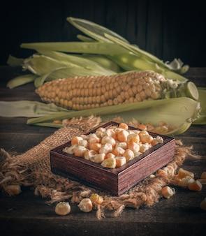 Corn cob raw on wood