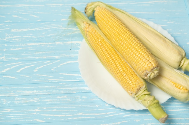 Corn cob on a wooden table
