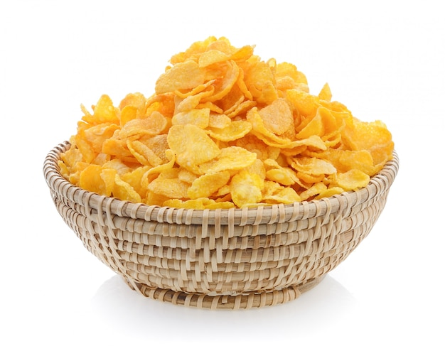 Corn flakes in basket isolated on white isolated