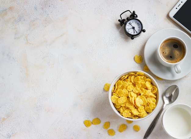 Corn flakes, coffee, alarm clock on light, breakfast