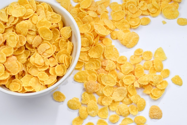 Corn flakes falling to the white bowl. motion. copyspace.