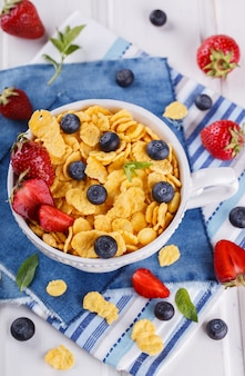 Corn flakes and fresh berries.summer healthy breakfast.