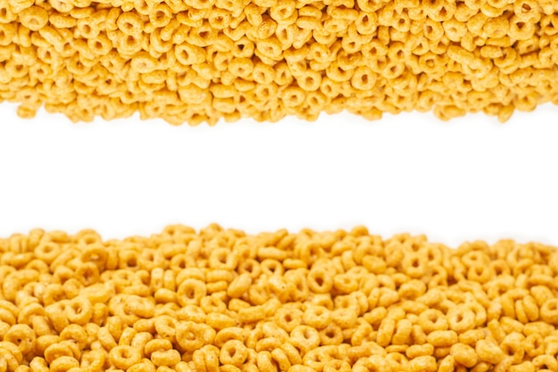 Corn-flakes surface and texture. top view. honey rings cereal box for morning breakfast.