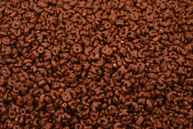 Стена и текстура кукурузных хлопьев. вид сверху. коробка хлопьев кукурузных хлопьев для утреннего завтрака.