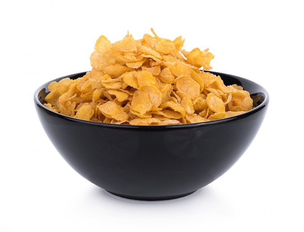 Corn flakes with milk in bowl