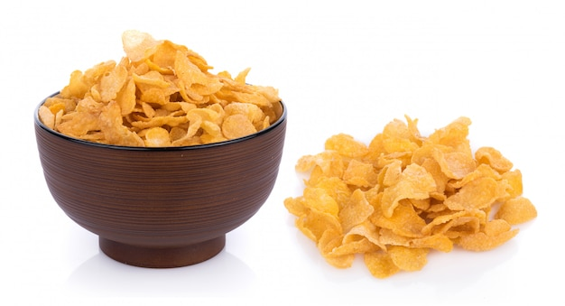 Corn flakes with milk isolated on white