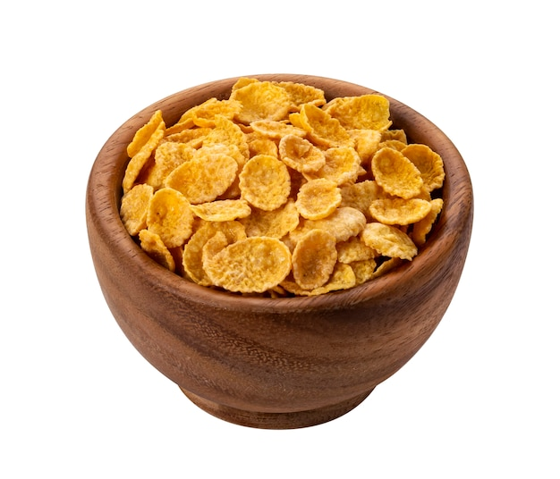 Corn flakes in wooden bowl isolated