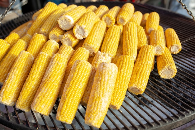 Corn on the grill. street food. vegetarian snack.
