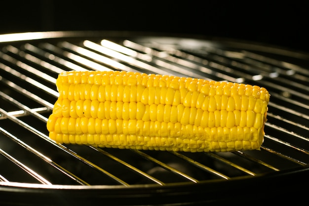Corn on hot grill