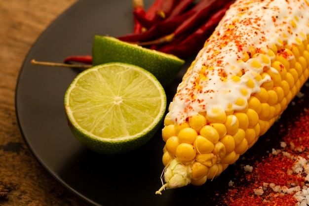 Corn on plate with limes close-up