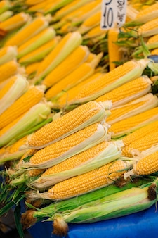 Corn sold in turkish market. counter with raw corn.