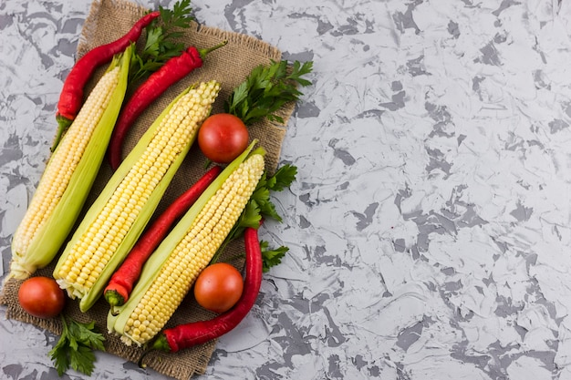 Corn and tomatoes with copy space