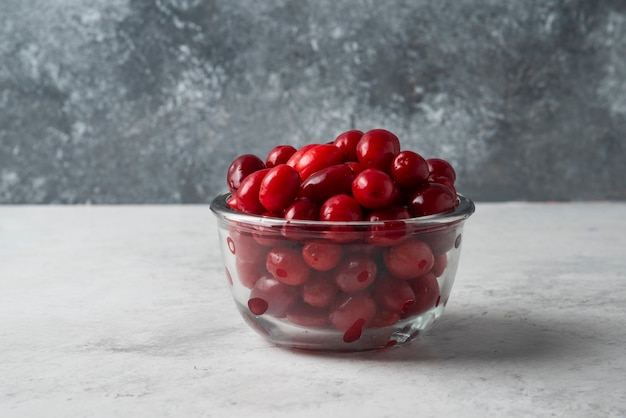 Cornel berries in a glass cup.