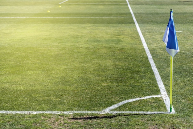Corner flag in a soccer field on a natural grass field