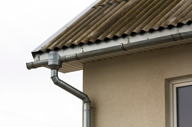 Corner of a house with a steel gutter system