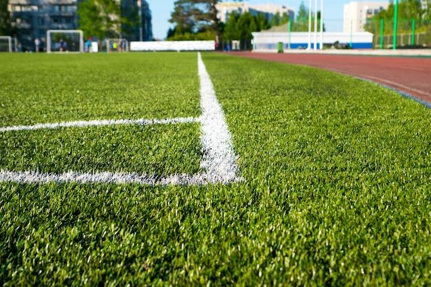 Corner soccer field on green artificial grass