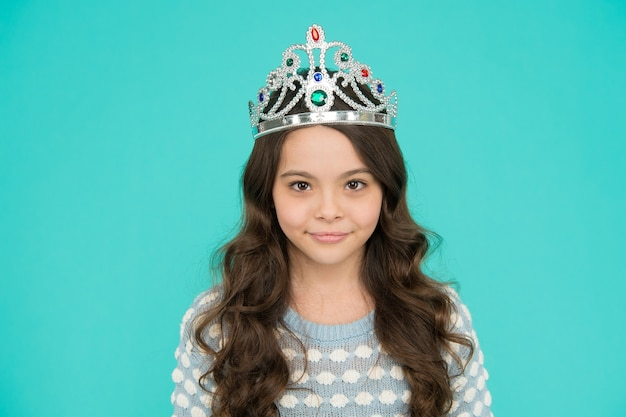Corona means crown. lady little princess. dreams come true. kid wear crown symbol of princess. girl cute baby wear crown blue background. small princess concept. every girl dreaming to be princess.