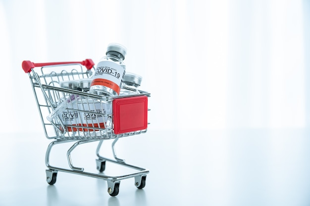Coronavirus 2019-ncov or covid-19 vaccine doses in a shopping cart with copyspace, an emergency and urgent covid19 vaccine distribution. covid-19 protection.