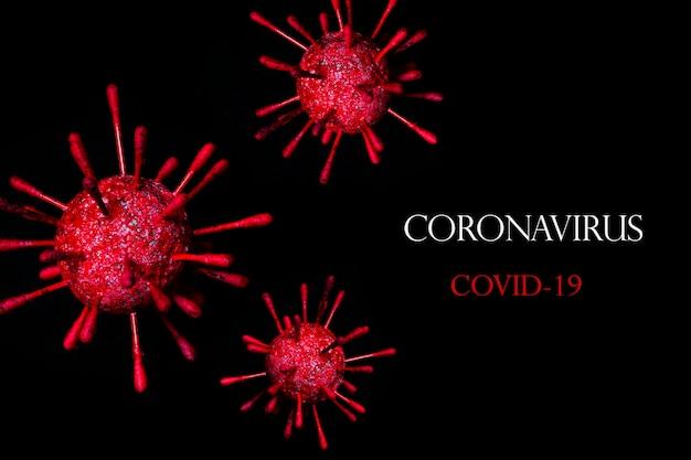 Клетки коронавируса на черном фоне. новая вспышка эпидемии