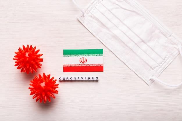 Coronavirus covid-19 concept. top view protective breathing mask and flag of iran. novel chinese coronavirus outbreak.