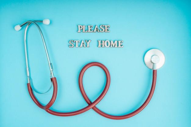 Coronavirus, covid-19. the inscription stay home. self-isolation and quarantine, personal protective equipment, phonendoscope and stethoscope