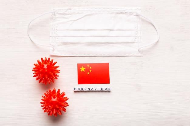 Coronavirus covid concept top view protective breathing mask and flag of china