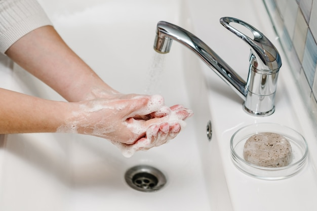 Coronavirus prevention. wash hands with antibacterial soap and warm running water rubbing nails and fingers in sink. washing hands. epidemic covid-19. prevention of flu disease.