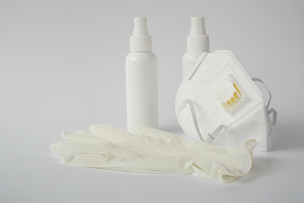 Coronavirus prevention with medical surgical mask and gloves, hand sanitizer alcohol spray
