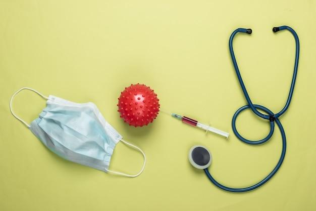 코로나 바이러스 백신, 진단. 바이러스 스트레인 및 주사기, 청진기, 녹색 마스크