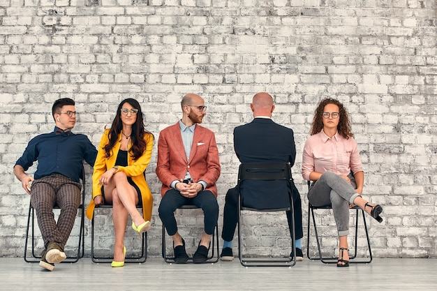 Corporate employees. business matters discussion. solid team ignoring lonely colleague.