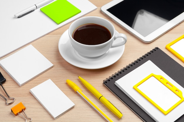 Corporate identity design template on wooden desk close up