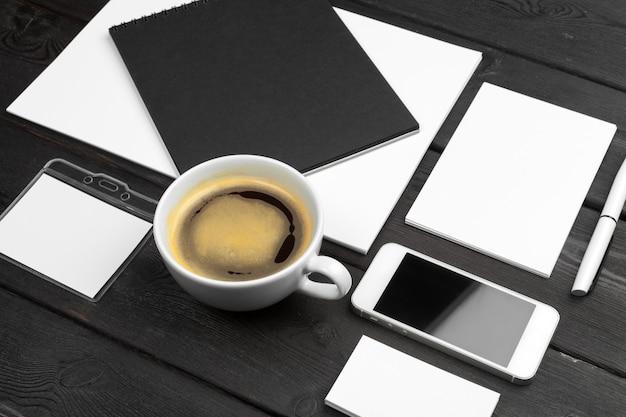 Corporate identity template, blank stationery set  on black stylish wood . mock up for branding, business presentations and portfolios.