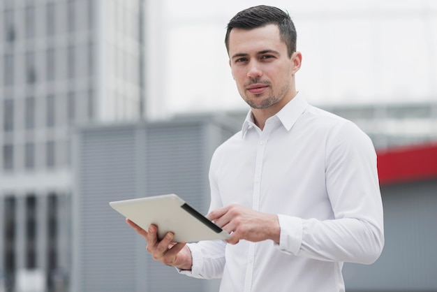 Corporate man holding ipad medium shot