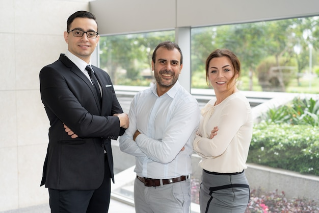 Corporate portrait of three members of successful business team