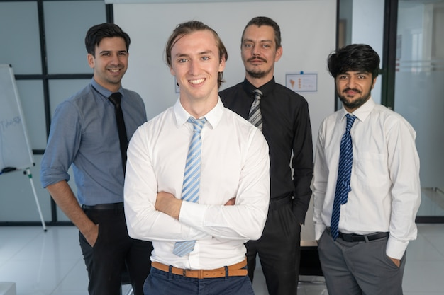 Corporate portrait of young manager and his team.