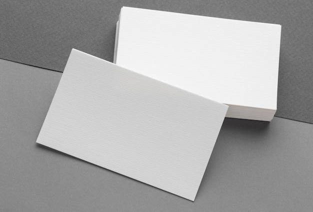 Corporate stationery blank business cards on grey background