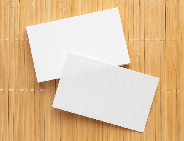 Corporate stationery blank business cards on wooden background