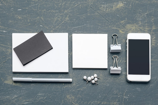 Corporate stationery branding with business card, pen, smartphone