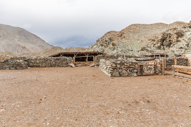 Corral near winter dwelling of the nomadic people on the hills of mongolia