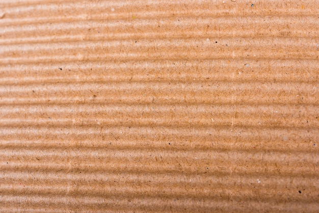 Corrugated brown cardboard sheet of paper texture or background